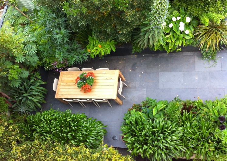 New garden furniture arrived this June, a reclaimed teak table surrounded by 'Air' chairs by Magis.