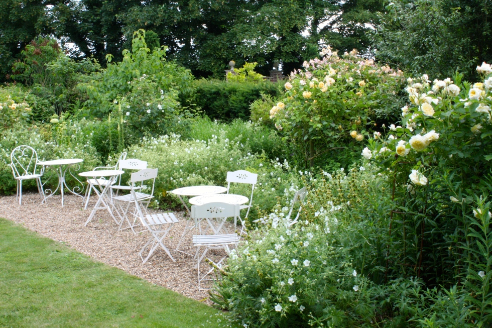 White geraniums, yellow aquilegias and cream roses in abundance in the The Yellow Garden