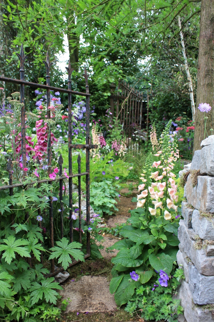 Nature takes hold in and around a ruined folly in this naturalistic garden