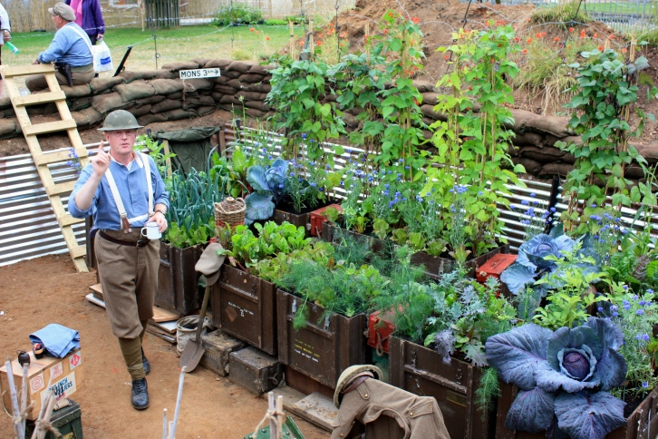 The 100th anniversary of the start of The Great War was commemorated at Hampton Court using gardens, flowers and even scarecrows