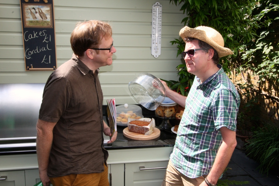 Friends Nigel and James sample the home-made cakes