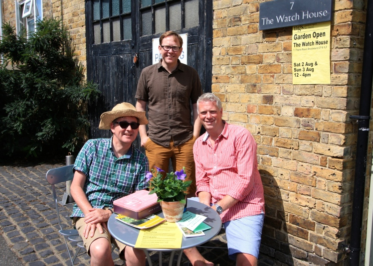 The men with the money, Nigel, James and Simon man the front gate