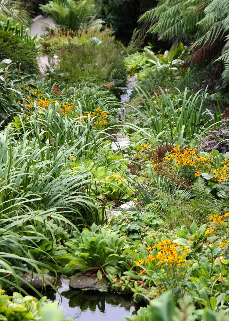 By early autumn, the vegetation in the Water Garden has almost obscured the complex layout of pools and cascades
