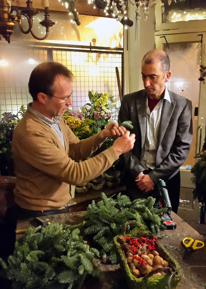 Pasi and Paul Jokinen-Carter show us how to wire on sprigs of festive fir