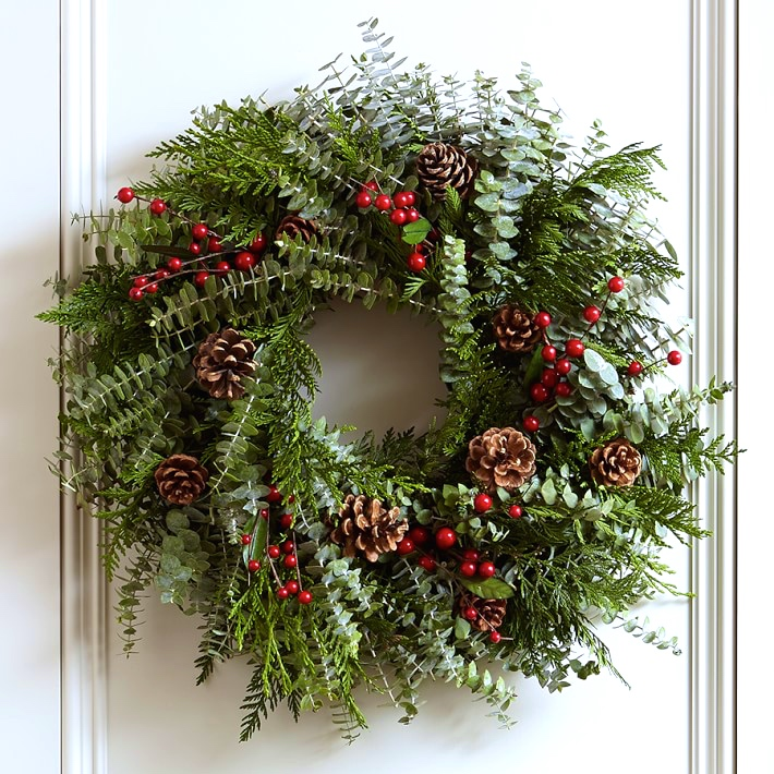 This dashing wreath is handcrafted from fresh cedar, eucalyptus, air-dried pinecones and faux berries.