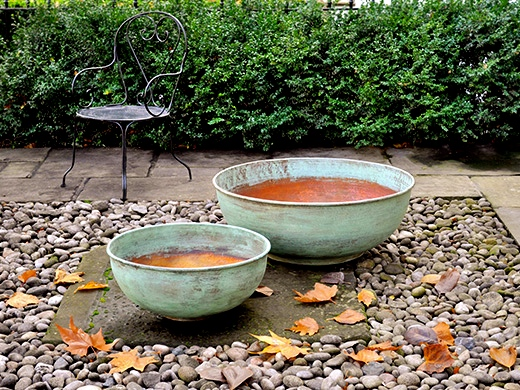 These copper basins have been allowed to develop their characteristic verdigris patina