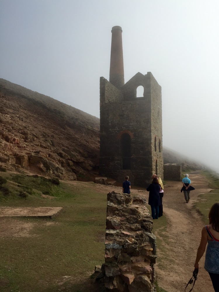 With the sun filtering through a light sea mist, the skeleton of Towanroath engine house appears vast and magnificent