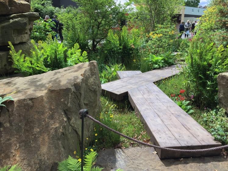 Heavy oak planks greet invite visitors into the garden