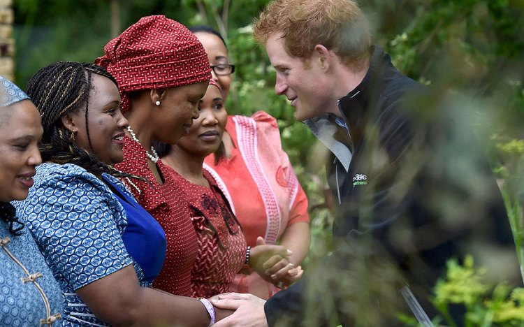 Prince Harry greets members of the Besutho Choir (Photo: Telegraph)