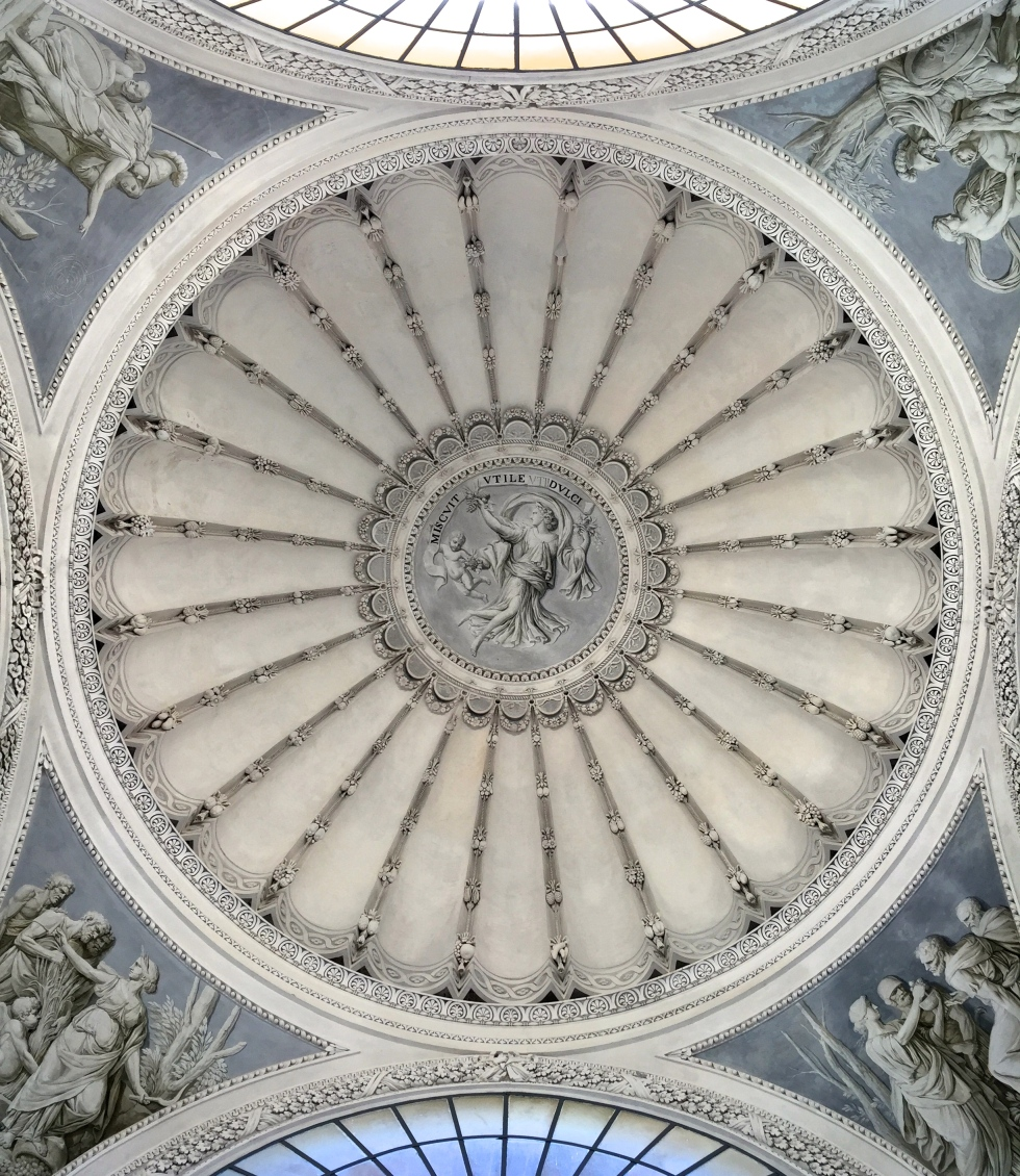 The dome of the Gymnasium reads 'Miscuit utile dulci', which translates as 'Mixed with sweet profit'