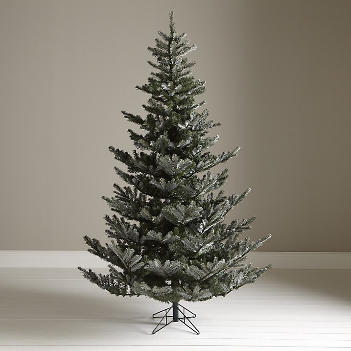 John Lewis' Silver Forest Spruce has an irregular outline which is ideal for decorating with glass baubles
