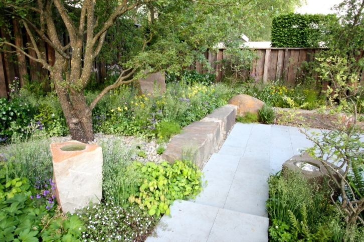 At the back of the M&G garden a generous terrace of smooth-cut sandstone was left refreshingly free of furniture