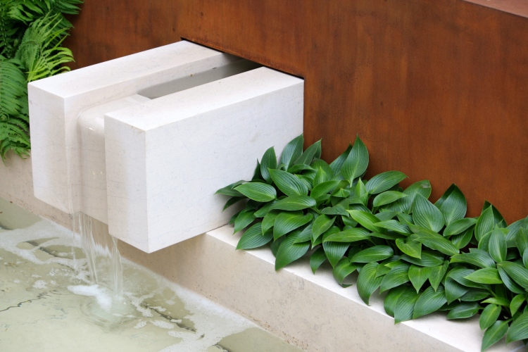 "The sublime simplicty of crisply-cut limestone, Corten steel and Hosta ""Devon Green"""