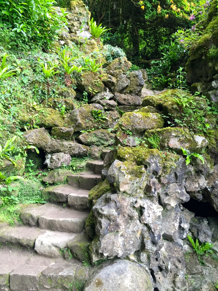 Stourhead's atmospheric Grotto is approached from a flight of rough steps forging a path beween craggy rocks